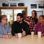 Zach Wahls with moms & sibling at kitchen table