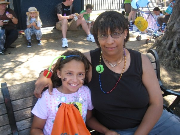 daughter & mother in OFC's Family Garden at 2009 SF LGBTQ Pride