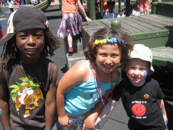 3 young kids mugging for camera in OFC's Family Garden at 2009 SF LGBTQ Pride
