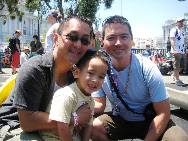 2 dads & toddler son in OFC's Family Garden at 2009 SF LGBTQ Pride