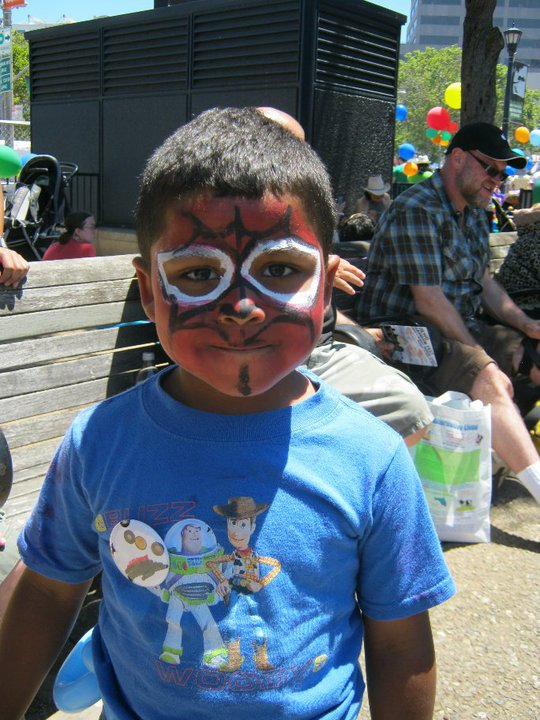 kid in face paint at OFC's Family Garden at 2010 SF LGBTQ Pride