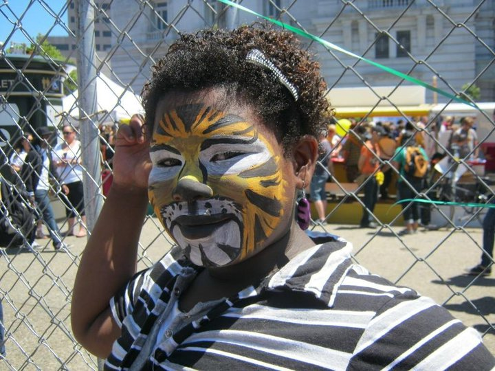 kid in face paint in OFC's Family Garden at 2010 SF LGBTQ Pride