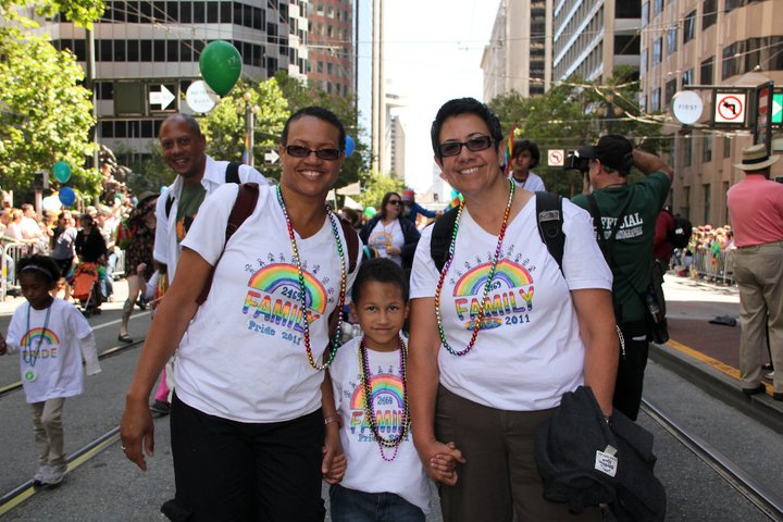 2 moms with young child at OFC contingent, 2011 SF LGBTQ Pride