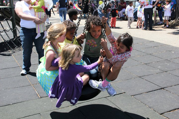 kids piling on swing at OFC's Family Garden, 2011 SF LGBTQ Pride