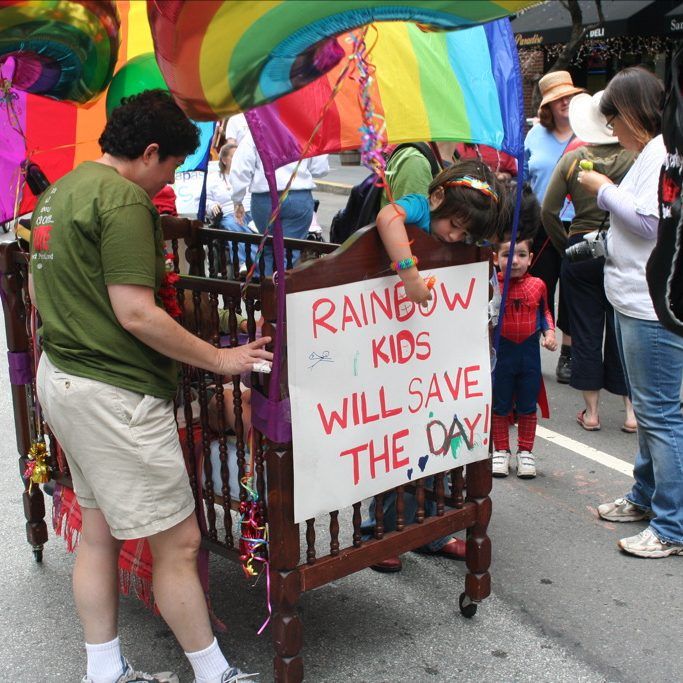 kids-in-pride-bedecked-mobile-crib