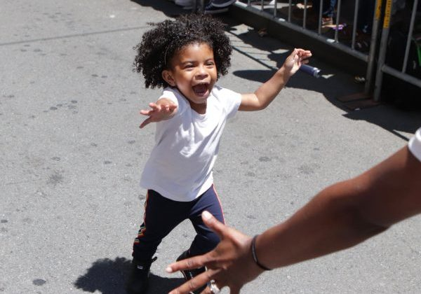 Happy child running towards someone's open arms
