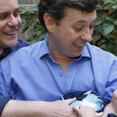 Gay couple Jeffrey Parsons (R) and Chris Hietikko pose with their son Henry Hietikko-Parsons in the garden of their house in New York on May 01, 2008. Henry was conceived by the couple via artificial insemination and a surrogate mother.Surrogates, who are paid about $20,000 above and beyond medical expenses to carry a child, are responsible for approximately 1,000 births a year, according to the Organization of Parents Through Surrogacy, that records births brokered through agencies and privately over the Internet.  AFP PHOTO/Emmanuel Dunand (Photo credit should read EMMANUEL DUNAND/AFP/Getty Images)